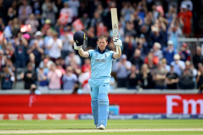 Eoin Morgan celebrates reaching his century at Old Trafford
