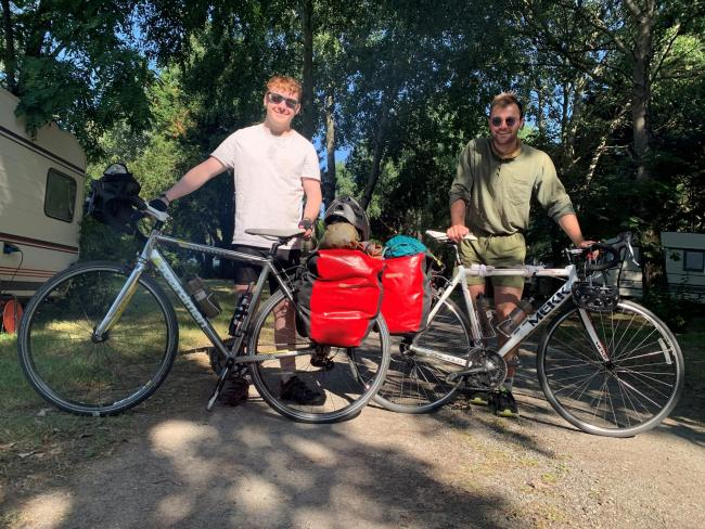 Josh Brain and Harry Davies-Ball take a breather during their 1,000-mile cycle ride along the cost of France