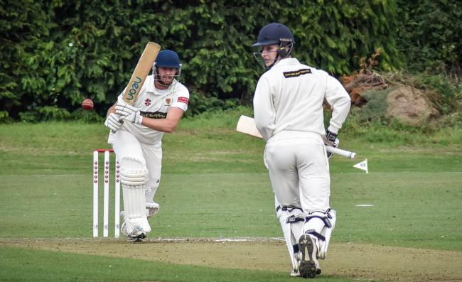 Hickerton and Slade making runs for Chippenham..Cricket action from Trowbridge v Chippenham. Chippenham  are batting .  (Delayed start due to wet wicket)..Photo by www.gphillipsphotography.com GP1736.