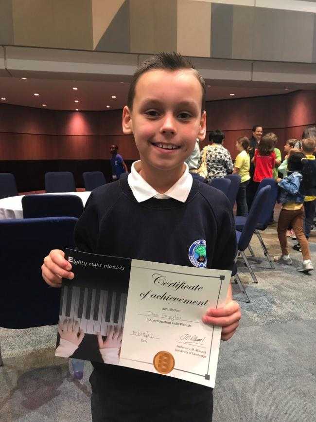 Theo Forsythe with his certificate for taking part in 88 Pianists