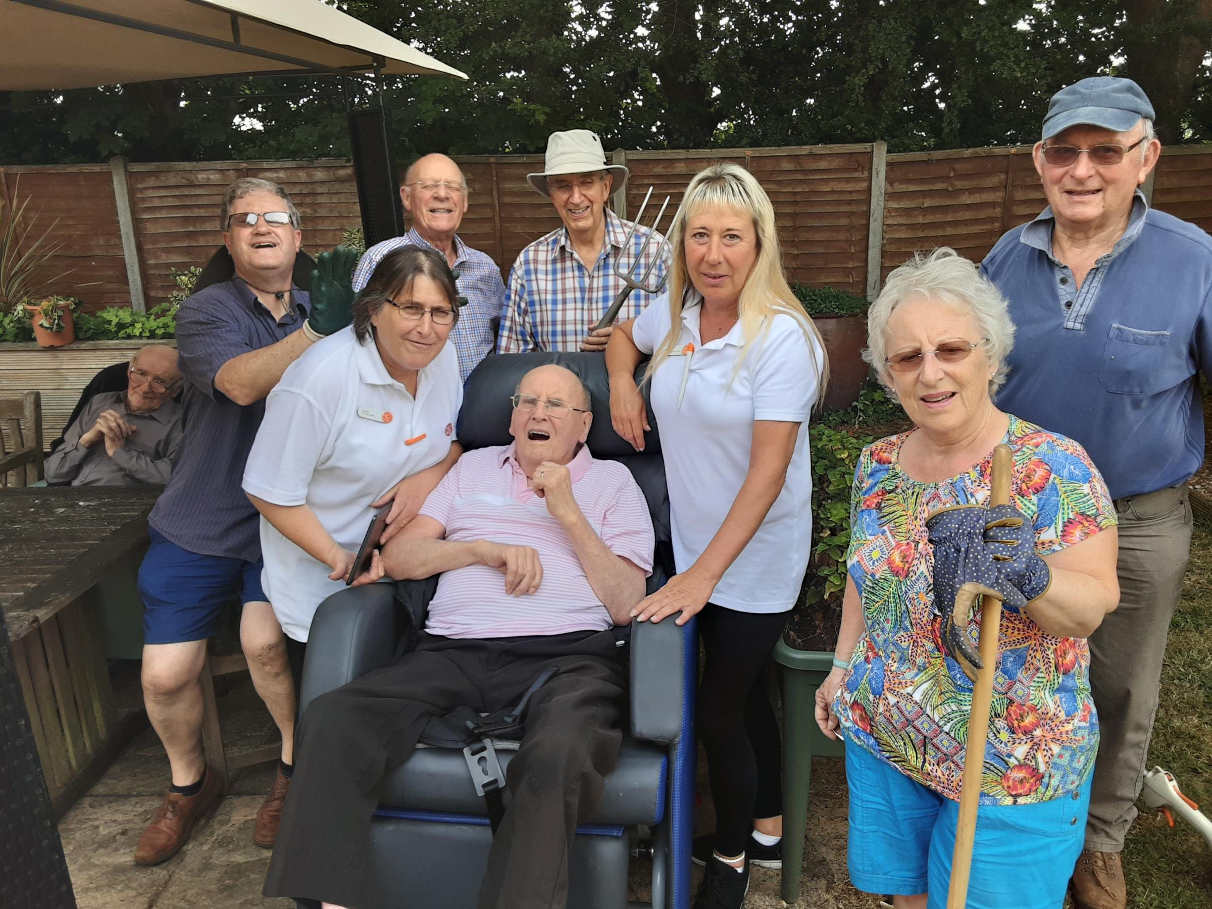 Chippenham Rotary Club spend the day working on care home's garden