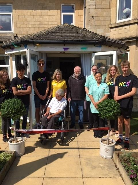 Wingfield staff and residents at the opening of the revamped garden