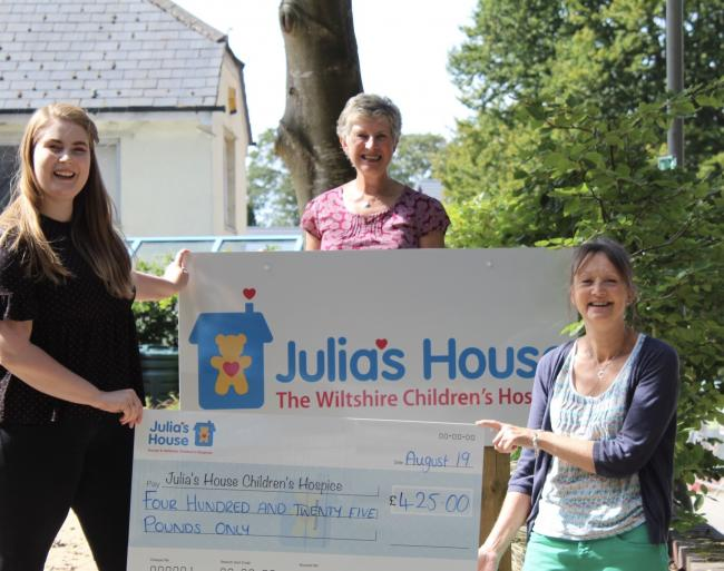Ann Berry and Pippa|Smith present the cheque to Claudia Hickling on their visit to Julia's House.