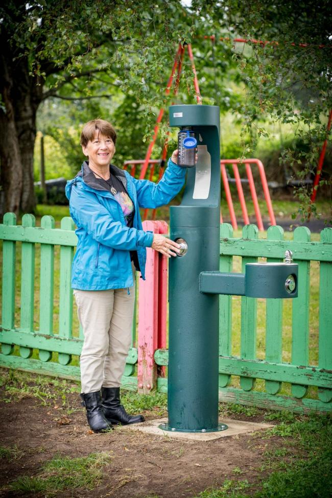Cllr Alex Kay with the Sladesbrook play area water fountain Photo: Lydia Booth Photography