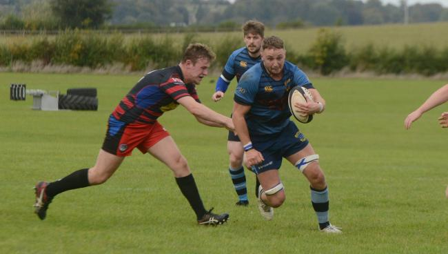 Rugby. BoA (red) v Melksham (blue). Pictured for BoA is Matt Cook and for Melksham is Nick Suter Photo: Siobhan Boyle SMB2817/5.