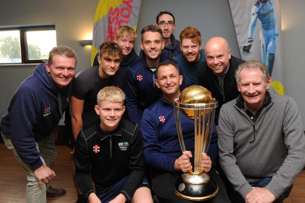 Cricket World Cup Trophy Chippenham . John Rumble Chairman of Chippenham Cricket Club  holds the Cricket World Cup Trophy surrounded  by members of the club.. The Trophy is travelling around Britain to clubs were players of the winning team once played-