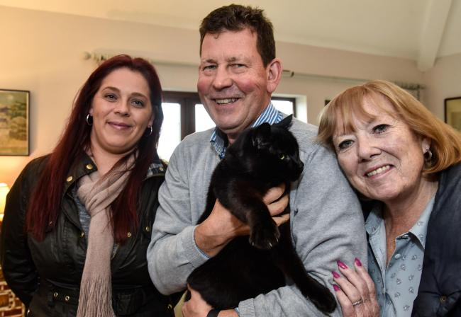 Mel and Rob Sargeant  owners of Clyde the cat, back home in Bradford on Avon after 6 years, with Zoe Wilmot (left) from Avon Park , Winsley where he had chosen to  stay all that time...Photo by www.gphillipsphotography.com GP1801.