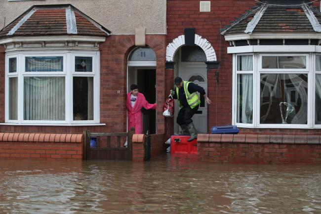 People try to negotiate floodwater in Doncaster