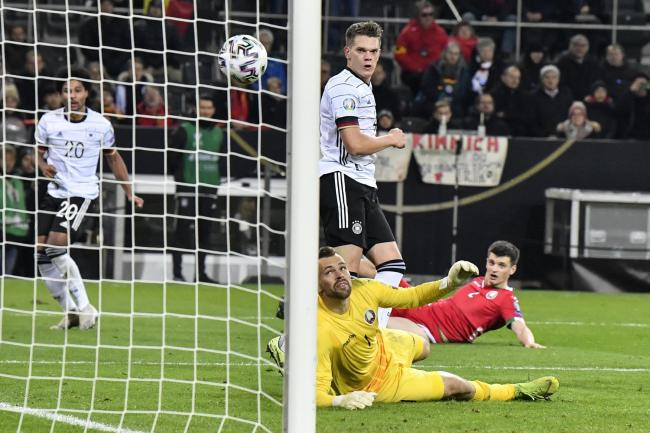 Matthias Ginter, center, scored a brilliant goal to open the scoring for Germany