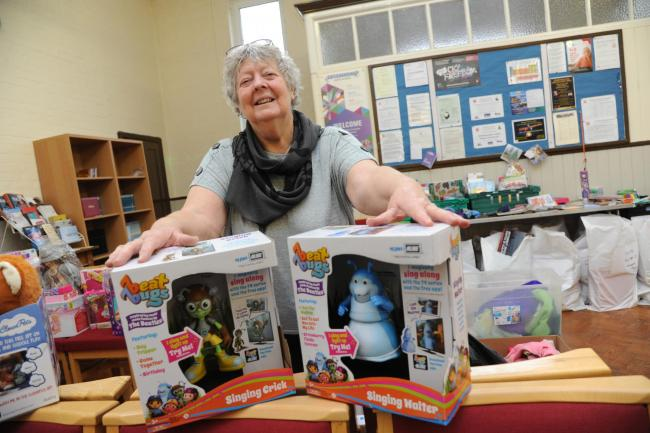 Heather Hauselman sorting out the toys for despatch at the Salvation Army							 Photo: Trevor Porter 66643 4