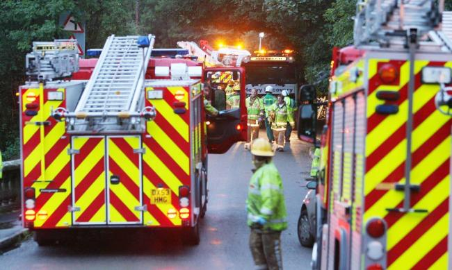 Emergency services at the scene in the village of Alton, Staffordshire, where a coach crashed down a steep bank leaving one man dead and several people in hospital.