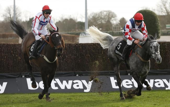 Who Dares Wins and Tom Cannon clear the last fence on Saturday.	                    PHOTO: PA