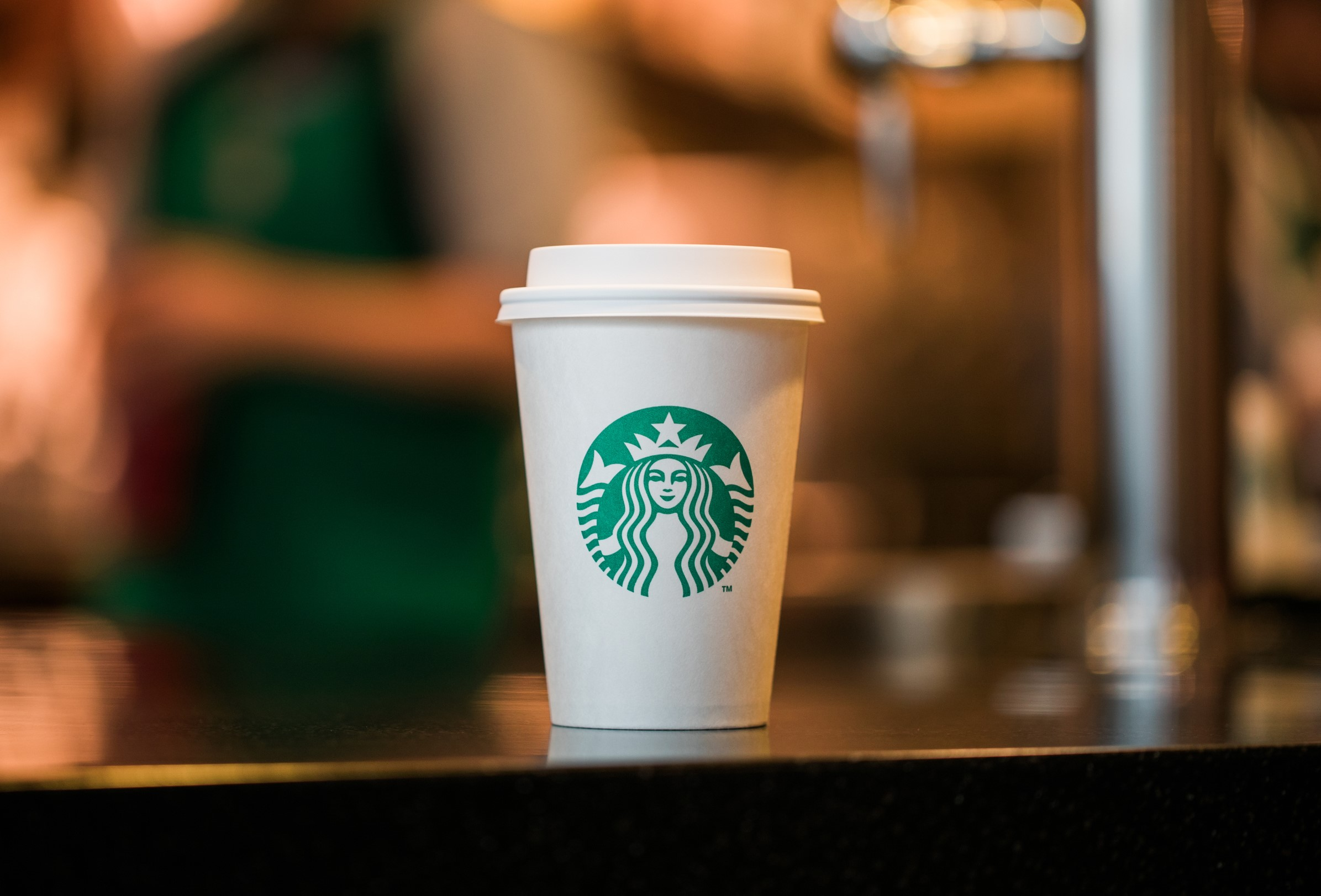 Starbucks pauses use of personal cups in coffee shops due to