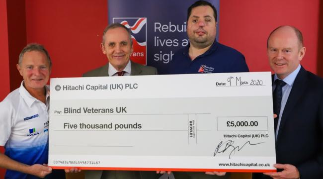 L-R Guy Munnoch, Nick Caplin, Simon Brown of Blind Veterans UK and Robert Gordon with the £5,000 cheque