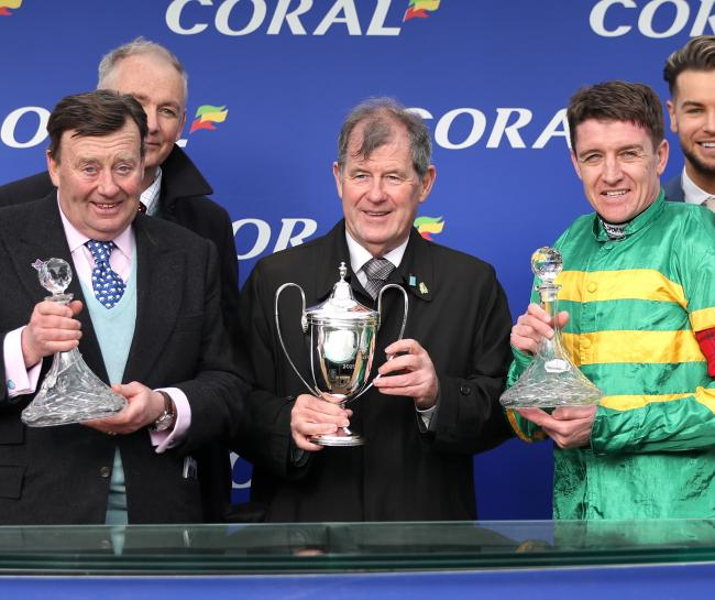 Nicky Henderson (left) alongside owner JP McManus and jockey Barry Geraghty 	      Pic: PA