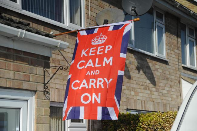 Bringing a smile in worrying times: Chris Bush's Keep Calm Carry On flag flying at St Mary's Gardens Photo: Trevor Porter 66787-1
