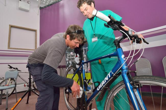 A doctor getting his bike checked. Picture: J Bewley/Sustrans