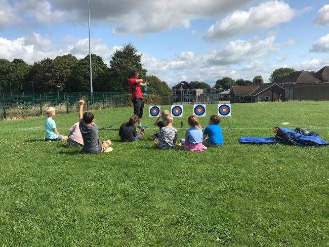 Children take part in an archery session at an Active Trowbridge kids camp