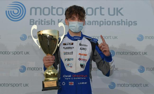 Louis Harvey celebrates victory in round one of the Motorsport UK British Karting Championship