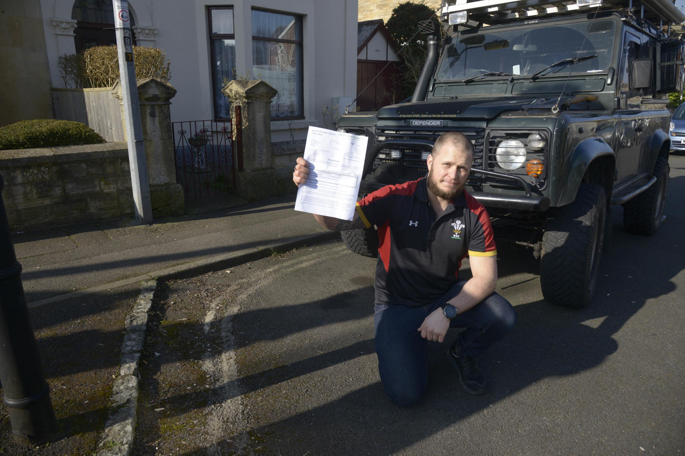 Gary Zelley fighting the council over a parking fine on removed yellow lines Photo Trevor Porter