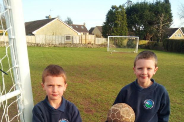 , Henry (10) and Duncan (7) Sparrowhawk at Northfield playing field in Winsley