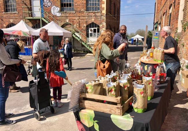 Visitors browse the Innox Mills Sunday Market on April 18