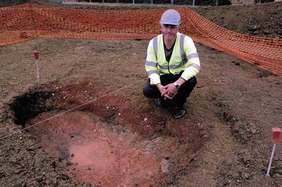 Archaeologist Alistair Barber at the mediaeval fire pit, possibly used to smelt iron