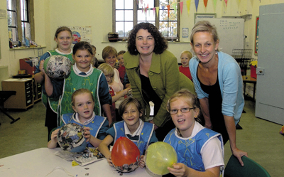 Headteacher Lyssy Bolton with associate head Rita Owen, right, and pupils at Wingfield, a year after the amalgamation with The Mead Community School