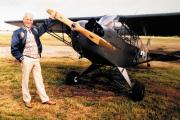 Jim Stoodley with a wartime aircraft like the one he flew when he was 13 in a bid to kill Adolf Hitler