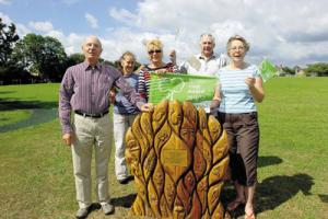 North Bradley wins a green flag award for its recreation area. Brian Bond with his carved seat memorial to late wife Elaine, fundraiser Pauline Baxter, Sue Hawker, Barry De Ath, and secretary Kay Thomas