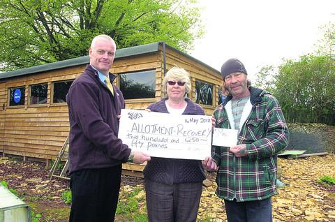 The grant handover at the allotments in Neston, with, from left, Wessex Water's Stuart Lewis, New Highway area manager Caroline Sharp and volunteer Norman King