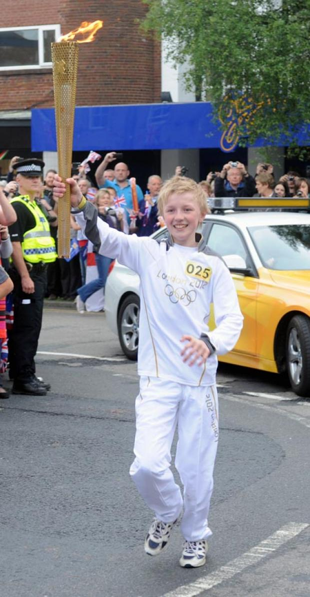 One of the torchbearers passes through the centre of Chorley.
