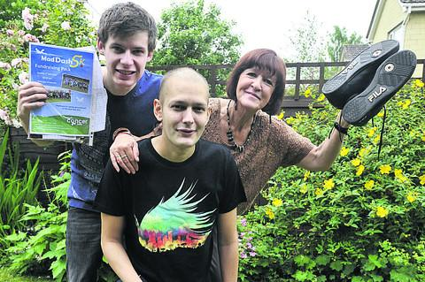 Leukaemia patient Daniel Henchman (centre) with brother Patrick and mum Catherine are raising money by running in Sunday's 5k Mad Dash for the Bath RUH Forever Friends appeal