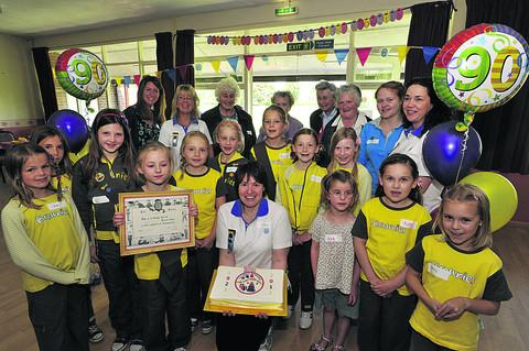 Seend Brownies, both past and present, with current leader Helen Hook, centre, celebrating their pack's 90th anniversary with a party