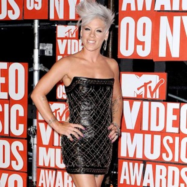 Pink says being a mum will not stop her being a 'rock chick'