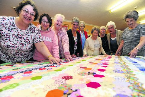 Wesley Road methodist Church quilters Joan and Nichola Whalen, Peggy Treaner, Joy Evans, Gwen Wilson, Doreen Banks, Wendy King, Marjorie Edgington and Kathleen Hooper