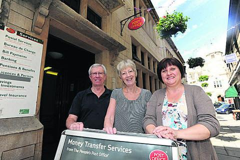 Alan and Sue Wallace with employee Hayley Grech at the re-opening in June