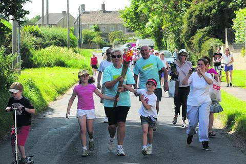 Co-organiser Chris Pitura carries the torch through the village