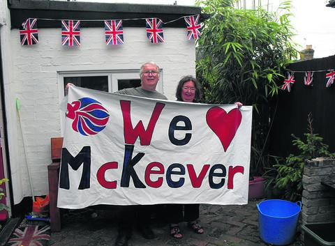 Derek and Janice McKeever display the banner to cheer on son Ed, right, in his bid for an Olympic kayak medal and, left, Trowbridge sprinter Danny Talbot