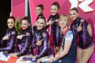 Rachel Smith, Louisa Pouli, Jade Faulkner, Francesca Fox, Lynne Hutchinson, coach Sarah Moon and Georgina Cassar celebrate their routine at Wembley Arena earlier today