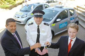 Inspector Dave Cullop receives the keys to two new Toyota Aygo community police cars from Platinum brand manager Peter James, left, and Felix Gummer of Tesco who are sponsoring the cars	(32135-1)