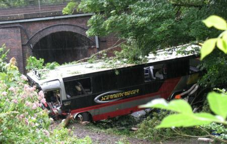 Shocking scenes as coach careers down hillside at speed near Limpley Stoke. 