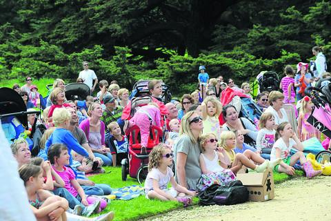 Picknickers watch the teddies fly
