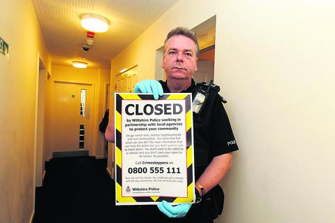 Sergeant Phil Connor closes a flat in a Monkton Park block