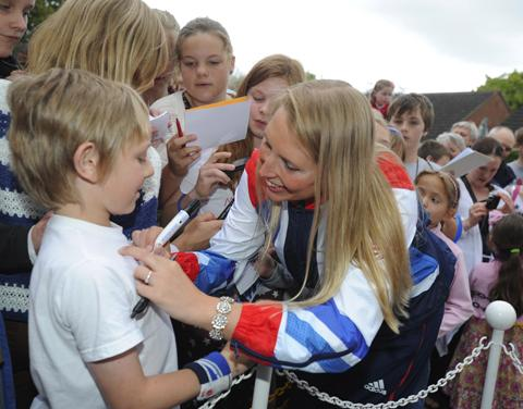 Stephanie Millward signs the T-shirt of one of her fans