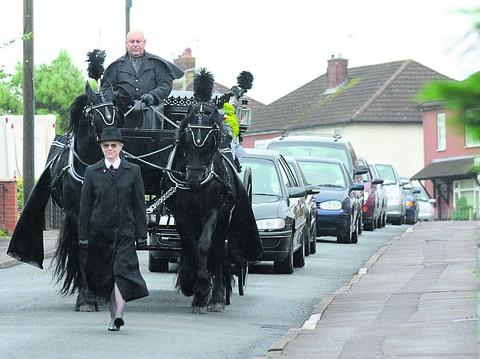 The funeral cortege for Shaun Hulbert