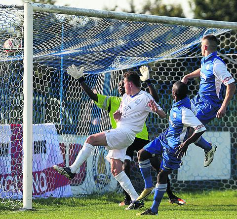 Brandon Barnes fires home Chippenham's winner at Bishop's Cleeve (Picture by Robin Foster)