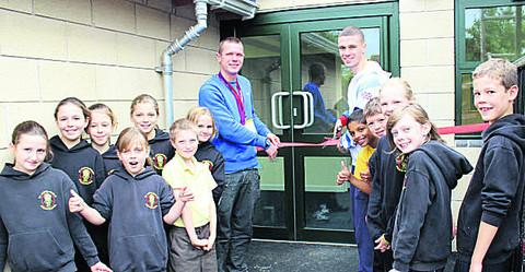 Danny Talbot and Aaron Moores open a building at St John's Primary School