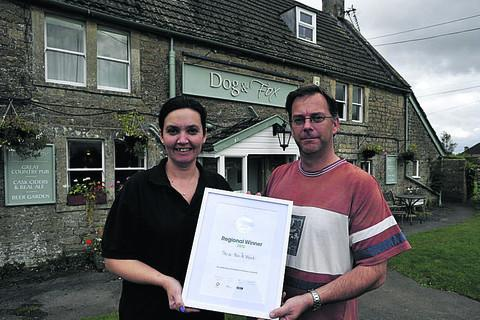 Andy and Joanne Wood of The Dog & Fox pub with their award