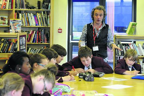 Author Andy Robb leads a writing workshop with pupils at St Augustine's College